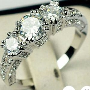 Ring with White Sapphire like Stones.